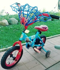 toddler's red and blue bicycle with training wheels null