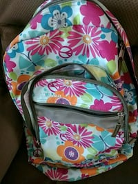 white and multicolored floral backpack