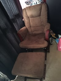 Brown rocking chair and ottoman