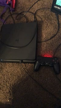 black Sony PS4 console with controller Phoenix
