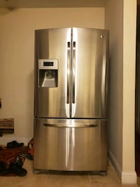 GE refrigerator for sale. Like new. $1000 negotiab Queens