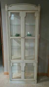 white wooden dispaly cabinet