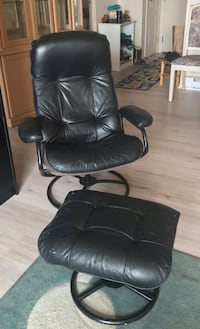 Black leather swivel reclining chair with separate foot rest Montréal, H1E 6V5
