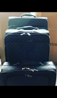 black and white travel luggage null