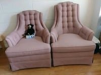 two pink fabric antique sofa chairs
