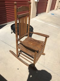 brown wooden rocking chair with ottoman