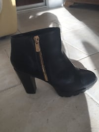 Black ankle boots with gold zip  Harrow on the Hill, Harrow, UK