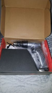 black and gray corded power tool with case 2276 mi