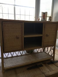 Rattan Shelf. 17 Inches Tall, 22 Inches Wide. 2 Compartments on top open for Storage. Great Condition  Cochrane, T4C 1K6