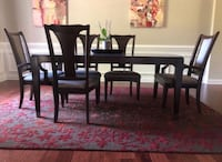 Dining room table, 8 chairs, two custom table covers