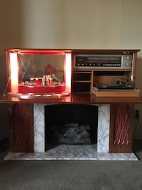 Fireplace with radio and bar