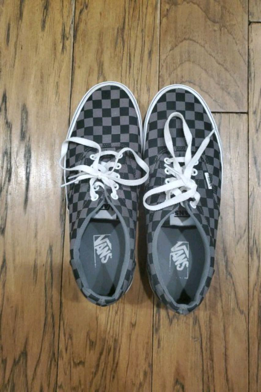 Photo Size 10 black and grey checkered laces vans.