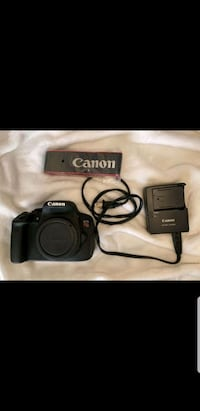 Canon Rebel T5i Digital SLR Camera with Lens Included