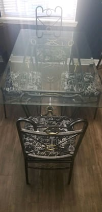 Glass Dining table with 4 iron chairs