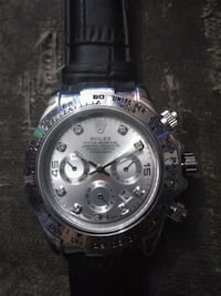 round silver-colored chronograph watch with link b Wilmington