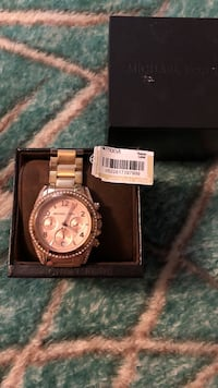 Michael Khors rose gold watch. Wore a few times. Needs new battery Hillsboro, 97124