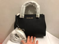 black and white Michael Kors leather tote bag