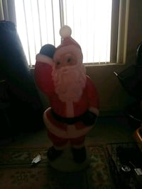 white, red, and black Santa Claus figurine Peoria, 85381