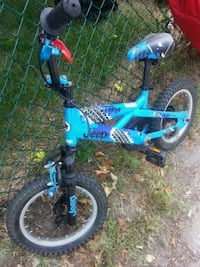 toddler's blue and black bicycle Toronto, M6E 4V2
