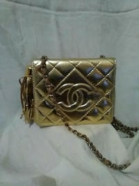 brown leather crossbody bag with gold chain link bracelet Las Vegas, 89123