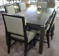 Solid dark wood table with 6 chairs