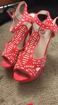 Red heels . worn 1 time . size 8.5