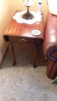 2 solid cherry end drop leaf tables 17x26 with sides up they are 33x26 coffee table is oval 29x36 they are in excellent condition. 175 for all 3
