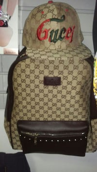 monogrammed Gucci backpack and hat
