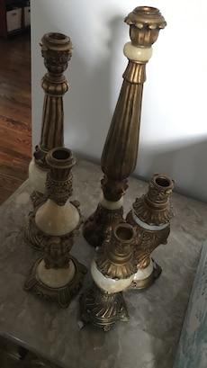 five brass candle sticks