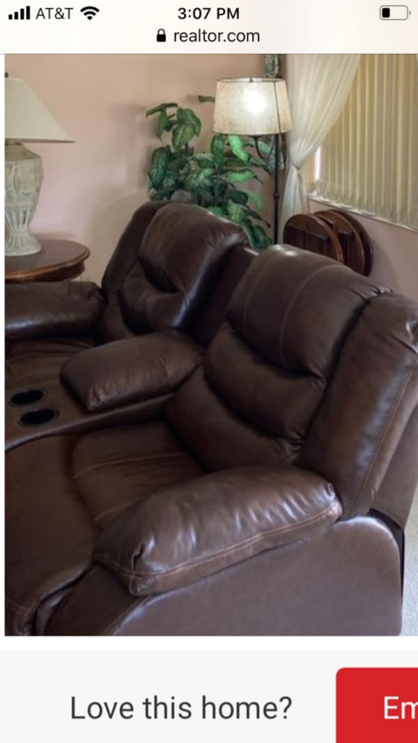 Brown 2 seater leather couch recliner. Storage with cup holders. 4a72ce7e-ef31-4458-8d8a-03ecf441d601