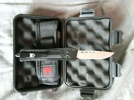 cobratec knife. opens with touch of button.(new) ( [PHONE NUMBER HIDDEN] .