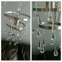 Uses one lightbulb. Plugs in.   Comes with 28 clea Whitby