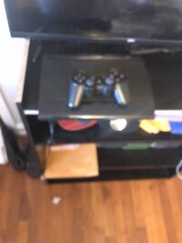 Black sony ps3 console with controller Washington, 20019