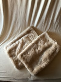 Faux fur, Cream colored pottery barn standard pillow covers.
