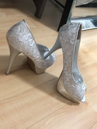 pair of gray leather heeled shoes Edmonton, T5G 0B6