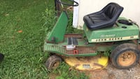 Green and black john deere ride on lawn mower needs work Front Royal, 22630
