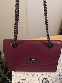 Plum color Coach purse. Dark suede inside