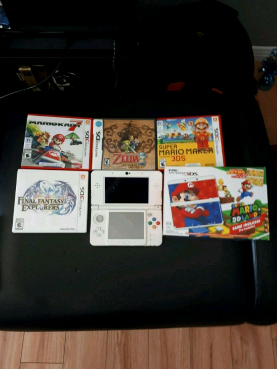 Used, white Nintendo 3DS with game cases for sale  Châteauguay