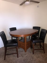 Round brown wooden table with four chairs dining set Tucson, 85718