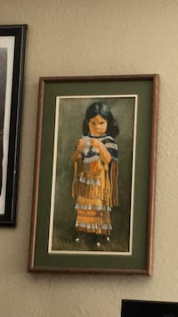 girl wearing dress painting with brown wooden frame