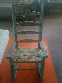 small grey wooden rocking chair