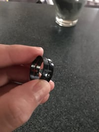 Silver-colored and black ring size 8 328 mi