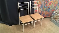 Two brown wooden & metal chairs