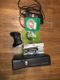 black Xbox 360 console with controller and game cases Norman, 73072