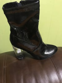pair of black leather boots Bartlett, 38134