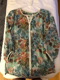 white, green, and red floral long sleeve shirt