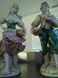 two man and woman ceramic figurines