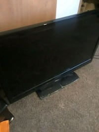 black flat screen TV with remote 288 mi