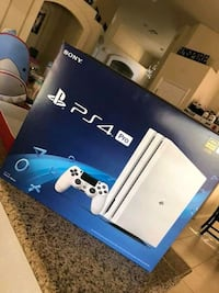 white Sony PS4 pro console in the box Washington