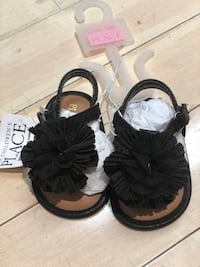 pair of black-and-white sandals Hampstead, H3X 1G7